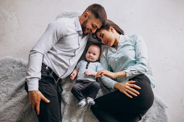 Happy family with their first child Free Photo