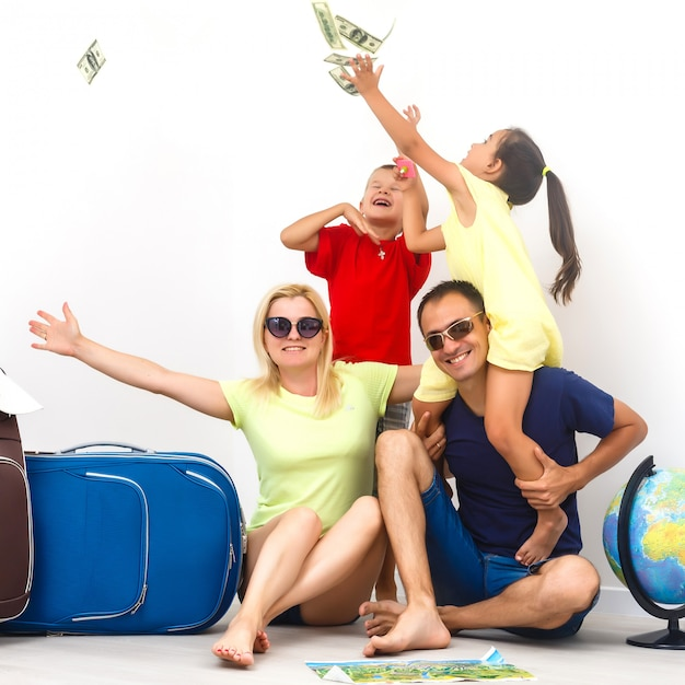 A happy family with their suitcases on a white Premium Photo