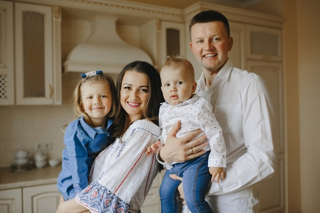 Happy family with two children in the kitchen Free Photo
