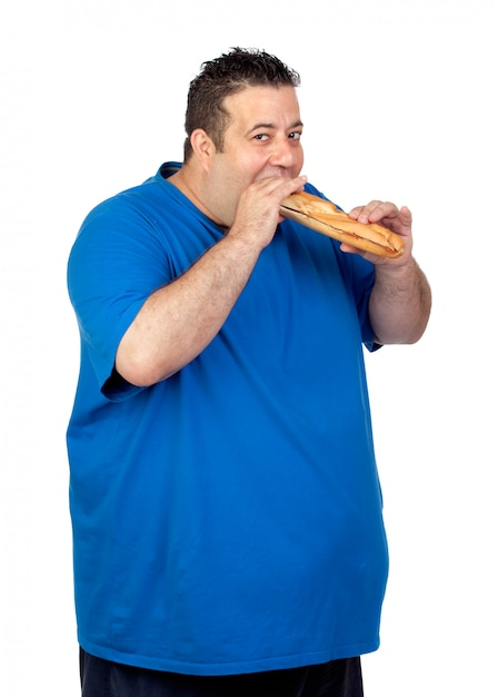 Happy fat man eating a large bread isolated on white background Premium Photo