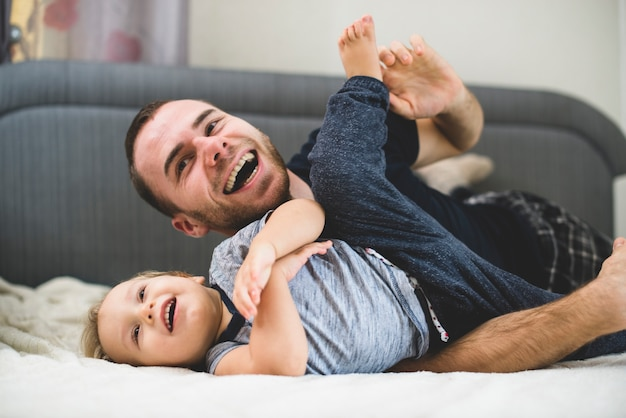 Happy father and son playing together Free Photo