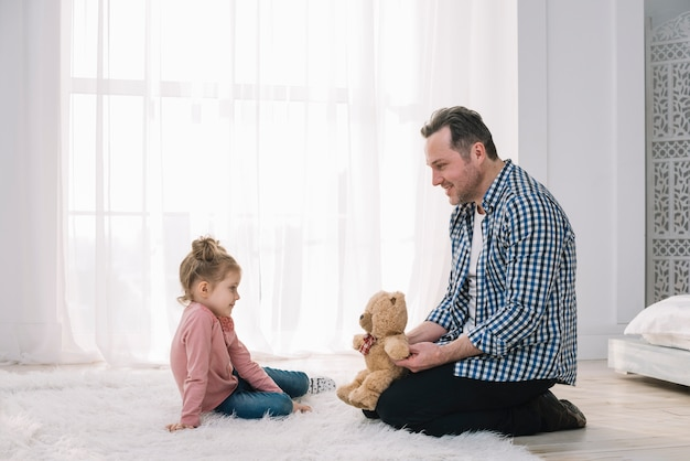 Happy father playing with his child in home Free Photo
