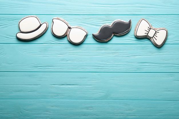 Счастливый день отца концепции. печенье на синем фоне деревянные. место для текста Premium Фотографии