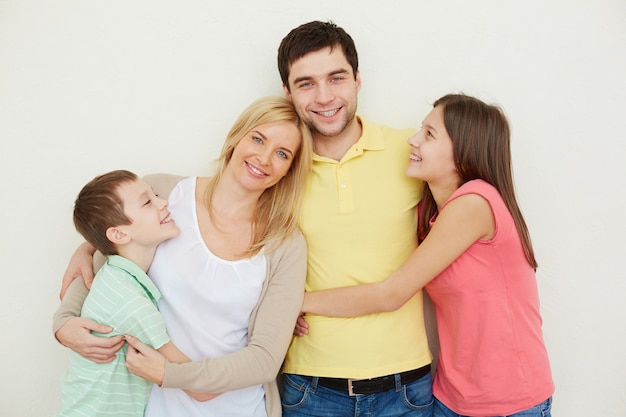 Happy father surrounded by his family Free Photo