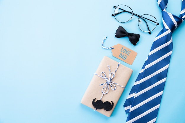 Happy fathers day concept on blue pastel background. flat lay. Premium Photo
