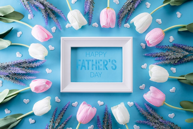Happy fathers day concept on bright blue pastel background. flat lay. Premium Photo