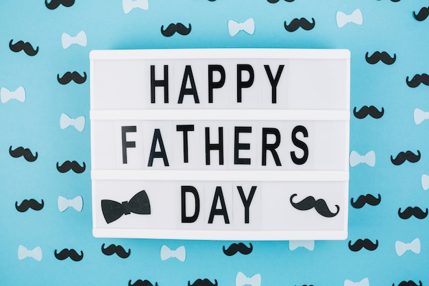 Happy Fathers Day Title On Tablet Between Decorations Photo Free