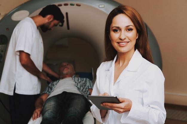 Happy female doctor mri in neurology clinic Premium Photo
