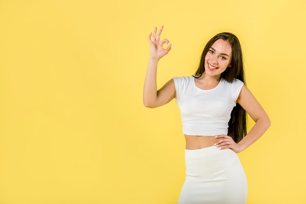 Happy female showing ok sign Premium Photo
