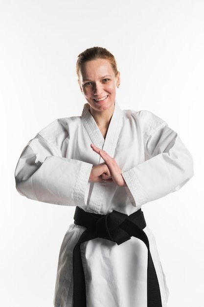 Happy fighter doing karate pose Free Photo