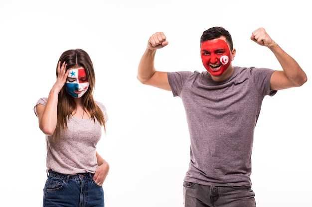 Happy football fan of tunisia celebrate win over upset football fan of panama with painted face isolated on white background Free Photo