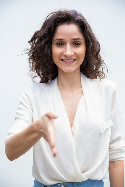 Happy friendly woman giving hand for handshake Free Photo