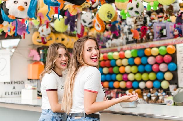 Happy friends in the amusement par Free Photo