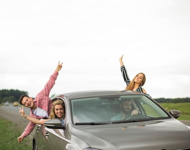 Happy friends enjoying the car trip Free Photo