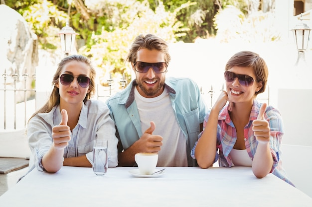 Happy friends enjoying coffee together Premium Photo