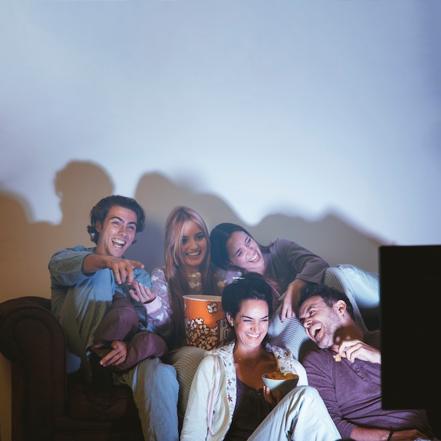 Happy friends having a movie night Free Photo