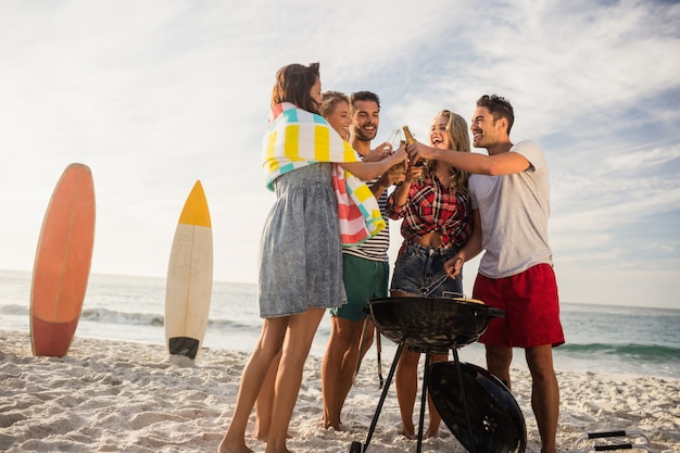 Happy friends having fun around barbecue Premium Photo