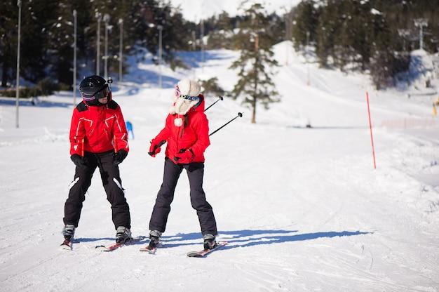 Happy friends having fun in mountains ski resort - nature and sport picture. Premium Photo