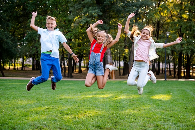 Happy friends jumping together Free Photo