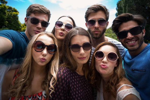 Happy friends posing for a selfie Premium Photo