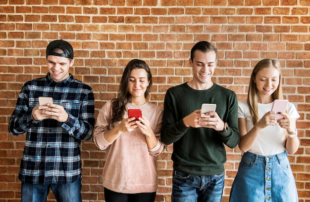 Happy friends using smartphones social media concept Premium Photo