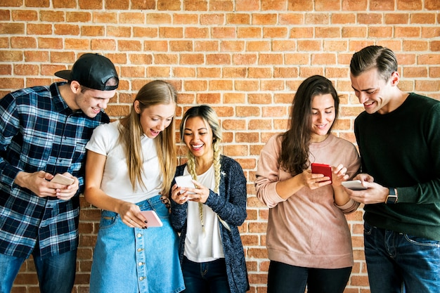 Happy friends using smartphones social media concept Premium Photo