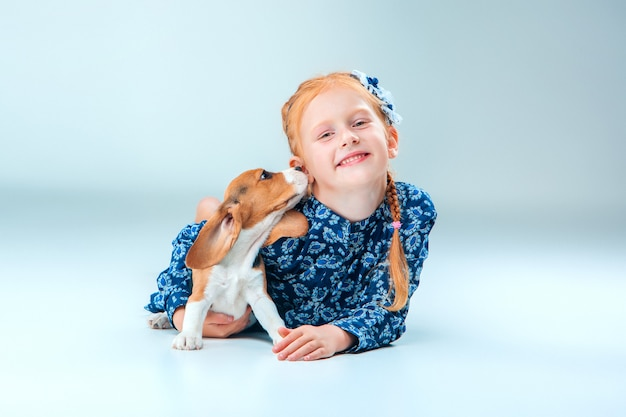 The happy girl and a beagle puppy Free Photo