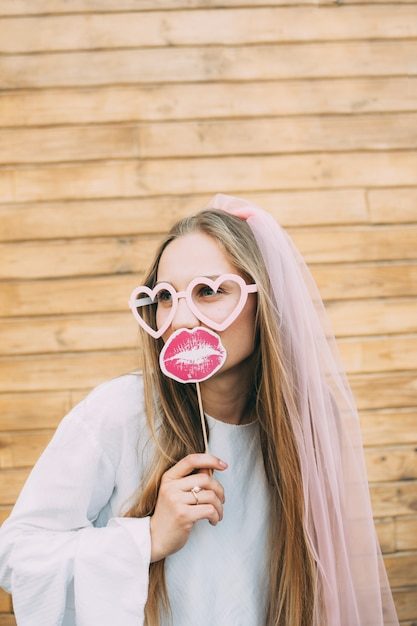 Happy girl bride with bridal veil having fun, hen-party, bachelorette, party concept Premium Photo