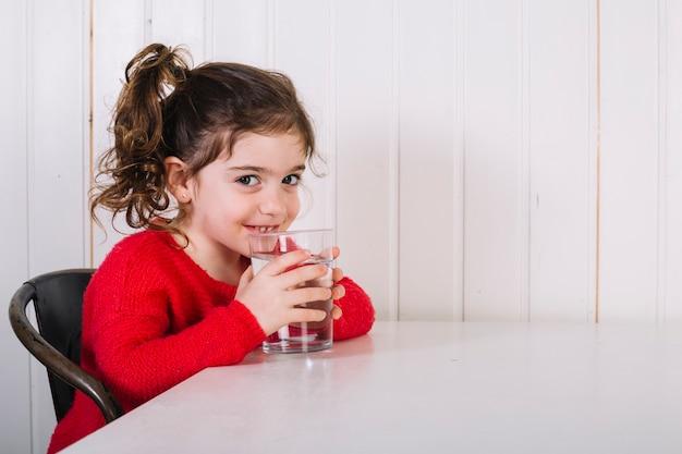Happy girl drinking water Free Photo