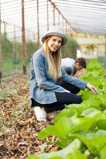Happy girl enjoying gardening Free Photo