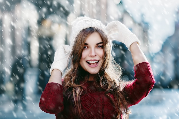 Happy girl laughing in snowy winter day new year banner Premium Photo