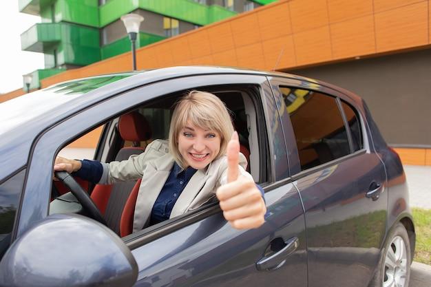 The happy girl passed the car driving exam Premium Photo