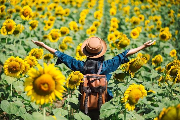 Happy girl in sunflower field. Free Photo
