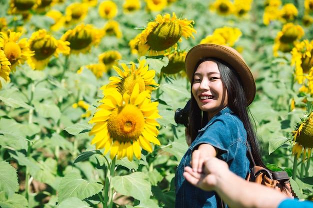 Happy girl in sunflower field. Free Photo