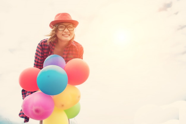 Happy girl with ballons Free Photo