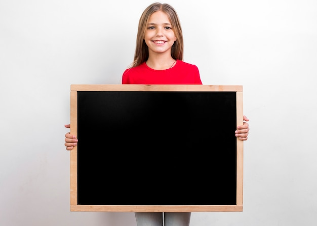 Happy girl with blackboard Free Photo
