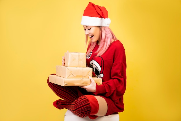 Happy girl with gifts in hands Free Photo