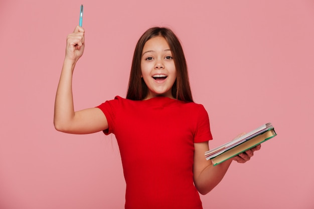 Happy girl with pencil and books have and idea an smiling isolated Free Photo