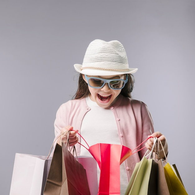 Happy girl with shopping bags in studio Free Photo