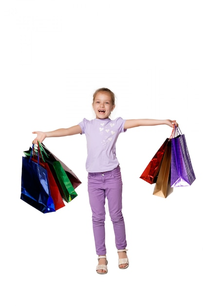 Happy girl with shopping bags Free Photo