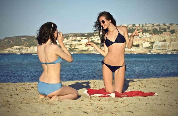 Happy girls on the beach Premium Photo