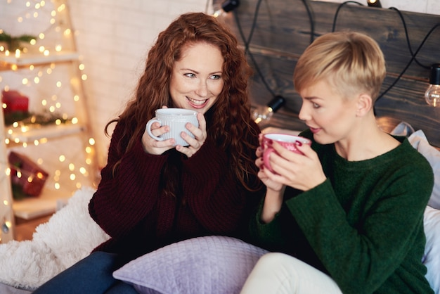 Happy girls drinking tea in bed Free Photo