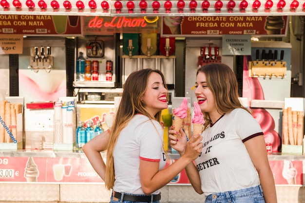 Happy girls having fun in the amusement park Free Photo