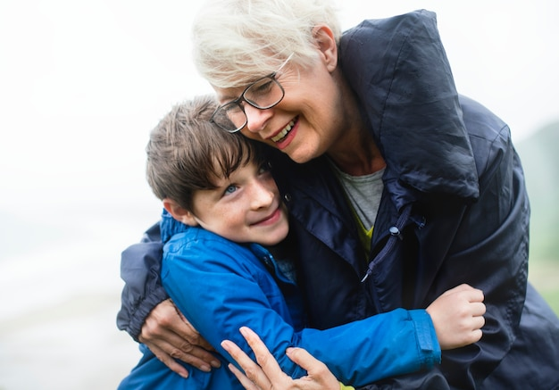 Happy grandmother hugging her grandson Premium Photo