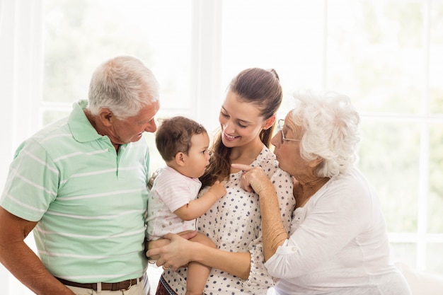 Happy grandparents playing with their grandson at home Premium Photo