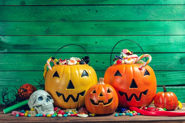Happy halloween! pumpkin with candy in the home. Premium Photo