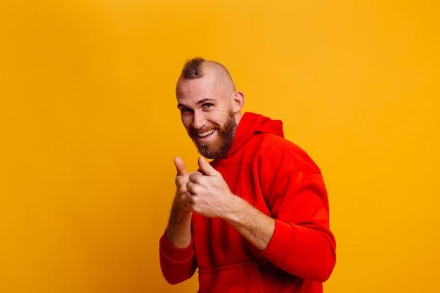 Happy handsome brutal bearder man wearing warm red winter trendy fleece hoodie Free Photo