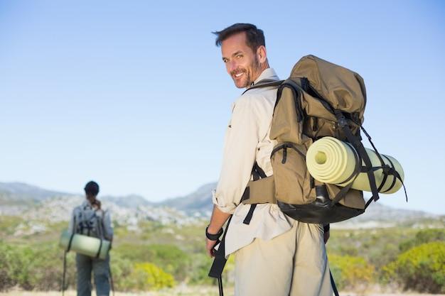 Happy hiking couple walking on mountain trail Premium Photo