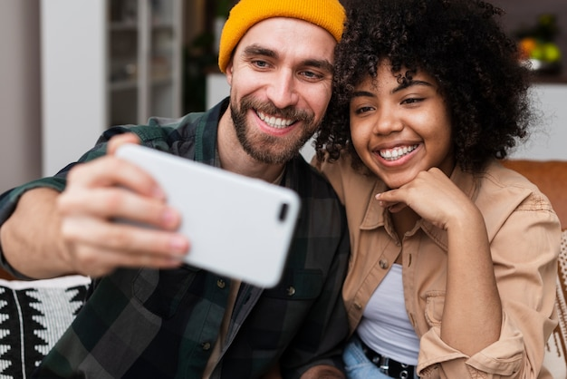 Happy hipster couple taking a selfie Free Photo