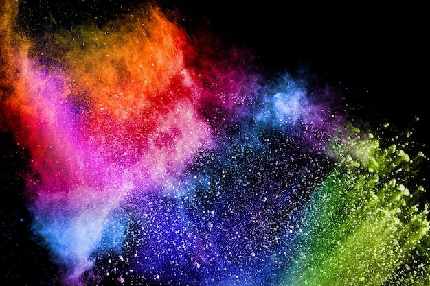 Красочный взрыв для порошка happy holi. цвет порошка взрыв фон. Premium Фотографии